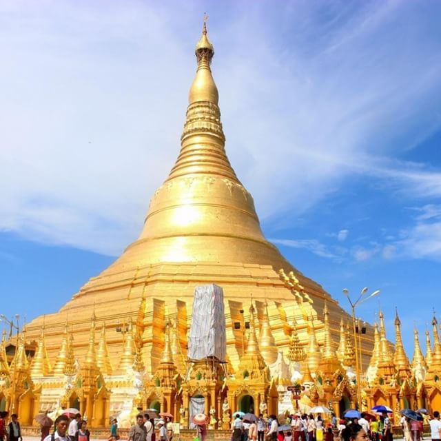 #ShwedagonPagoda is one of the most beautiful buddhist temples in #Myanmar. When we were there, the place was full of visitors and not possible to take a picture of just the tower of the pagoda. It dominates the #Yangon skyline at 99 meters in height. http://www.mariacomestotown.com/temples-of-worship/