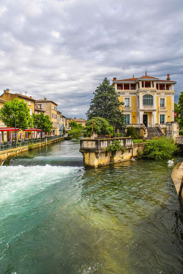 """On the route to """"Le Mas des Herbes Blanches"""": Shops of Isle sur la Sorgue. This is a small Provencal town, near Avignon, crossed by the river Sorgue"""