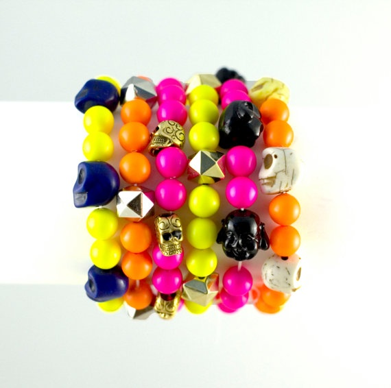 Swarovski beads neon beads neon bracelet skulls buddha beads pink orange yellow. $17.00, via Etsy.