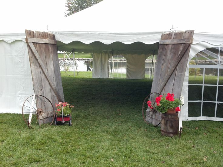 I love this idea. Anyone have old barn doors laying around? Lol a rustic spin on tent wedding