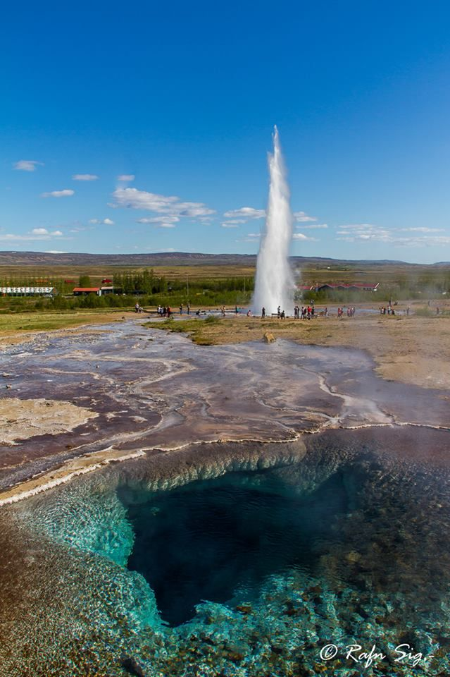 Strokkur , Iceland... a part of the Golden Circle... photograph of this spouting geothermal area, with the crystal clear waters revealing the amazing beauty just under the Earth's skin. Wow