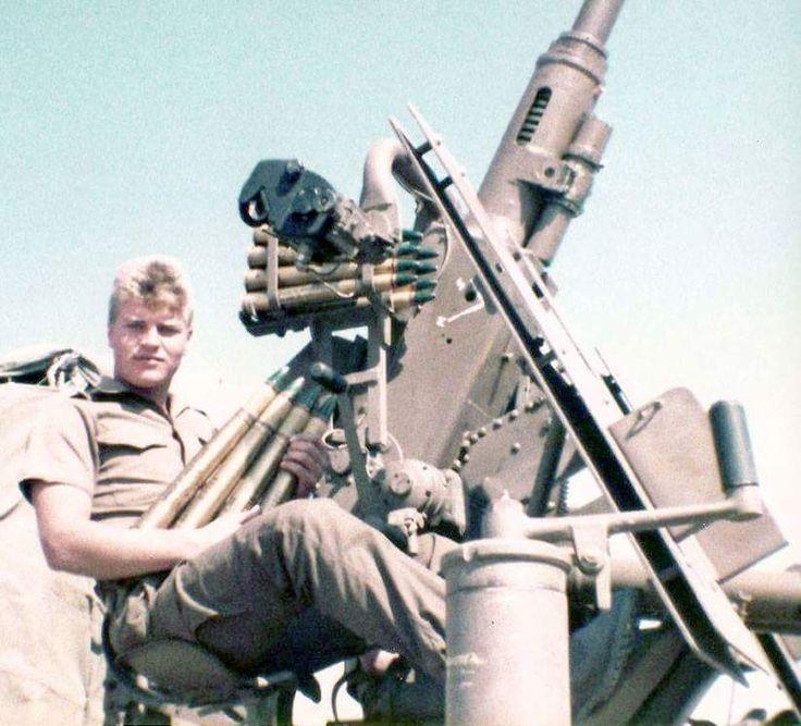 SADF soldier tries the Angolan anti-aircraft gun.