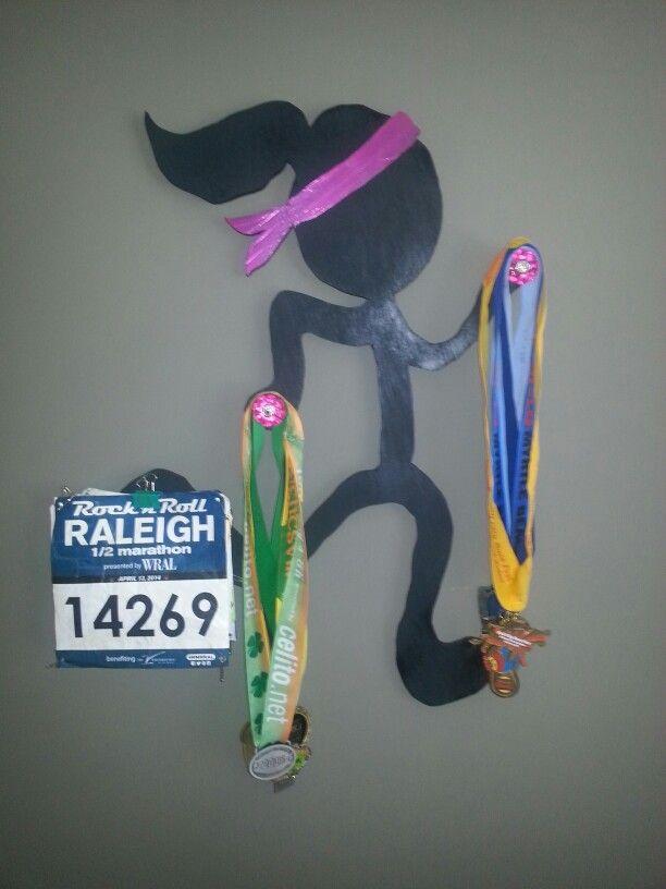 Marathon race metals and bib display