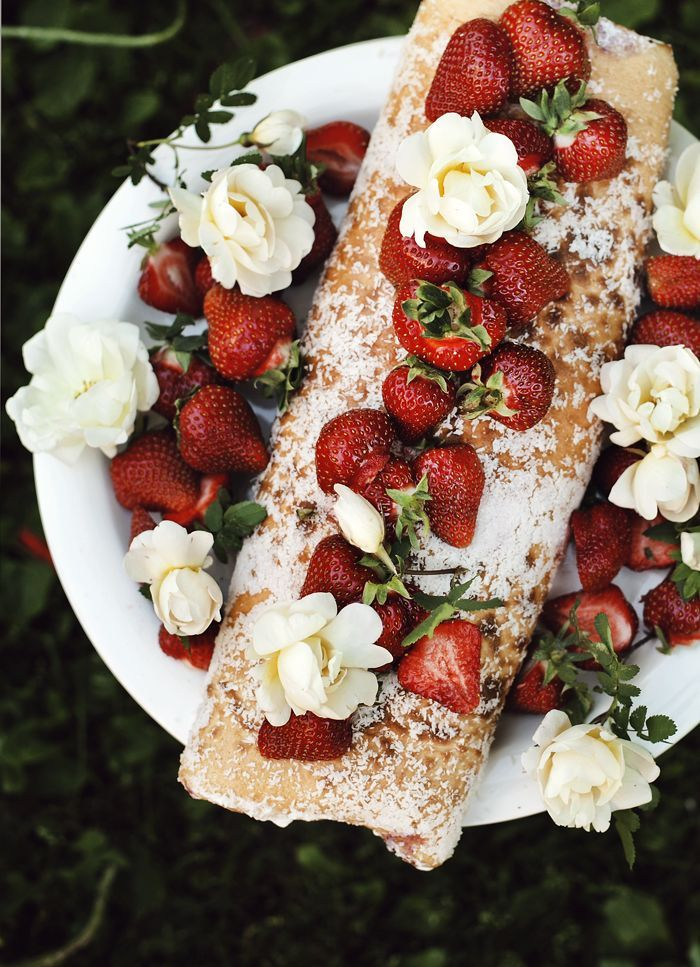 Traditional finnish kääretorttu; rolled cake with fresh strawberries, cream-yogurt mixture and Burnet roses.