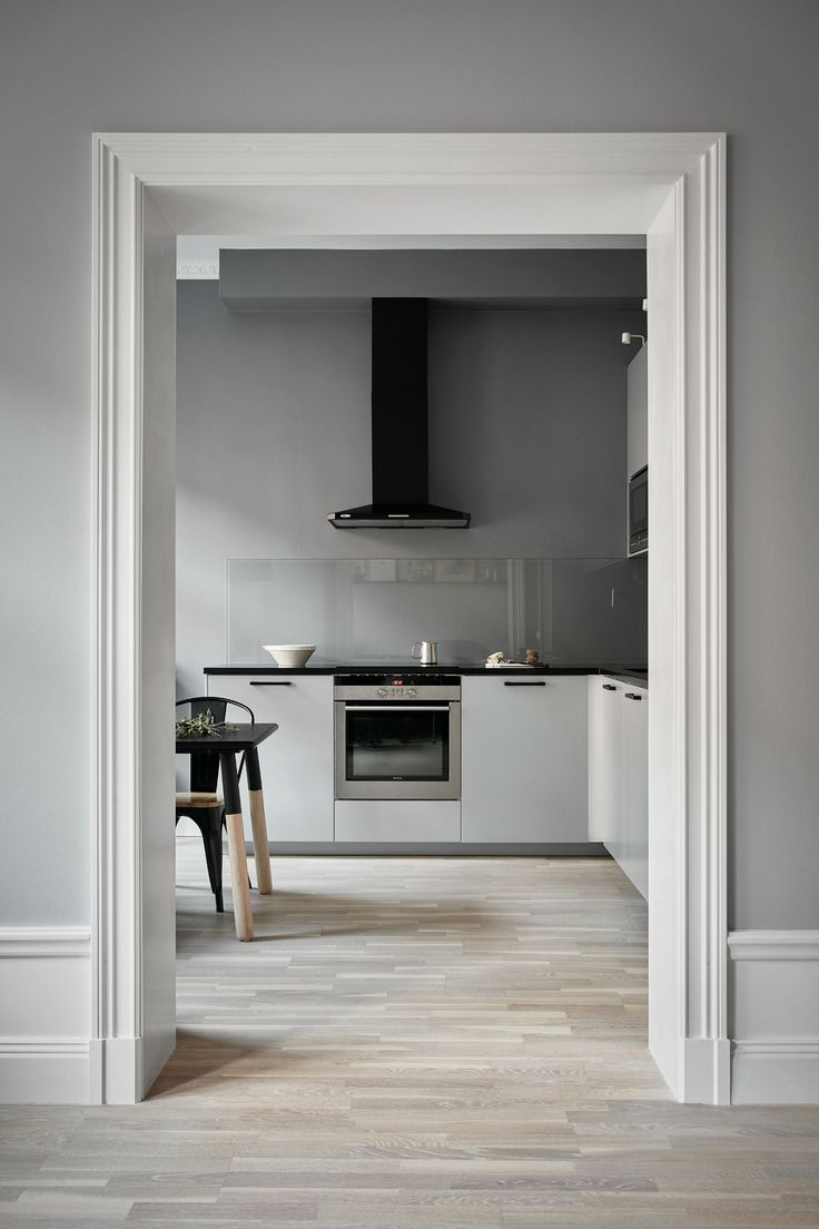 kitchen in a lovely apartment in grey shades at fantastic frank via http://www.scandinavianlovesong.com/