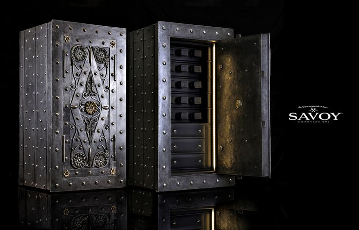 Bespoke antique safes equipped with watch winders, cigar humidors and liquor cabinets.