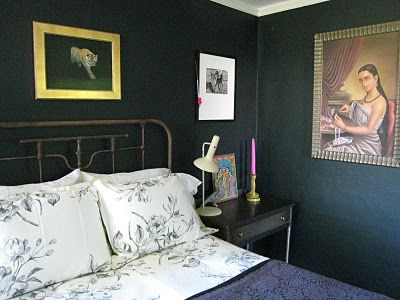 Farrow  Ball Black Blue. Love the pairing of tiger walking out of the dark painting, white matted pic  metal bed frame.