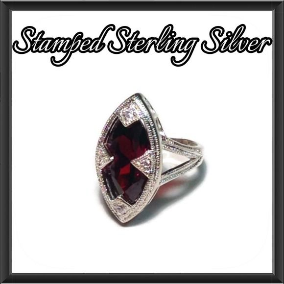 Sterling Silver Red Marquise Cut Ring Complete your jewelry collection with the chic head turning ring! The sterling silver setting is stamped 925 and features a large marquise cut blood red stone framed in sparkling white accent stones. Never been worn NWOT Jewelry Rings