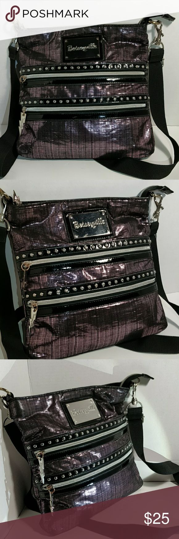 Betseyville crossbody travel bag slightly used...has a small scratch on main emblem see last picture. Betseyville Bags Crossbody Bags