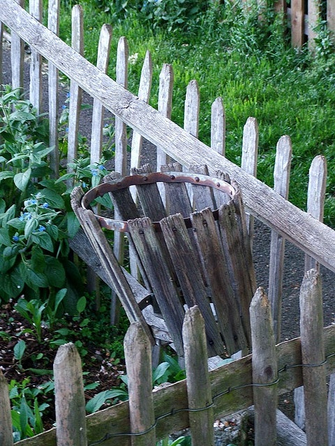 Rustic Garden, love the fence and basket