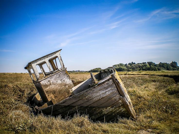 An Abandoned Fishing Boat at the Salt Marshes, Thornham Creek on the North Norfolk Coast.