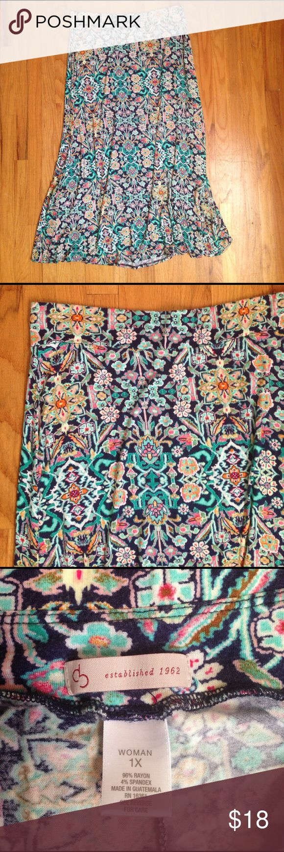 """Printed Maxi Skirt Printed Maxi Skirt. Abstract floral design. 96% rayon, 4% spandex. Covered Elastic waistband. Unstretched, the waistband is approx 18"""" across laying flat. Length is 37"""". Dress Barn Skirts Maxi"""