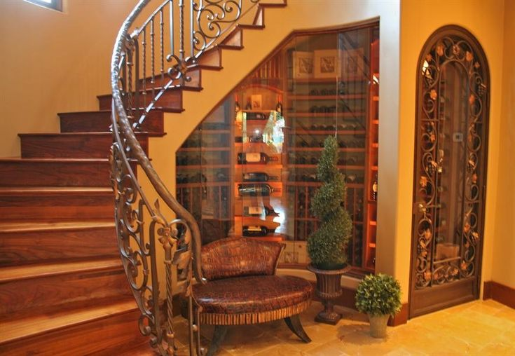 Love Glassed In Wine Cellar Under Stairs With Decorative