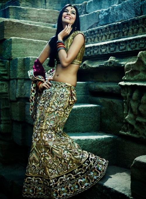 encrusted gold lehenga with dark purple dupatta. south asian bridal lehenga