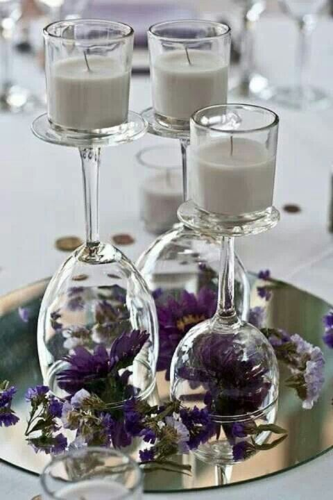 Wine glass center piece absolutely gorgeous! Can put anything under the glass and different candles ti match theme