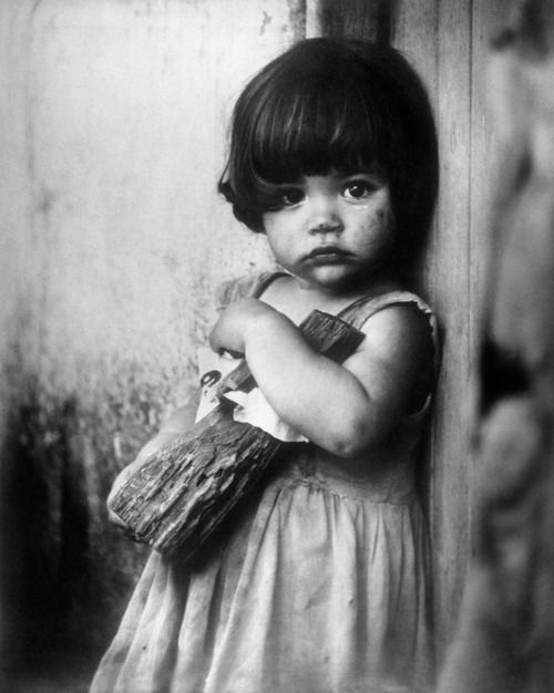 """Little girl in Cuba taken in 1955 by the famous Cuban photographer Korda. The piece of wood is her """"doll"""" for her."""