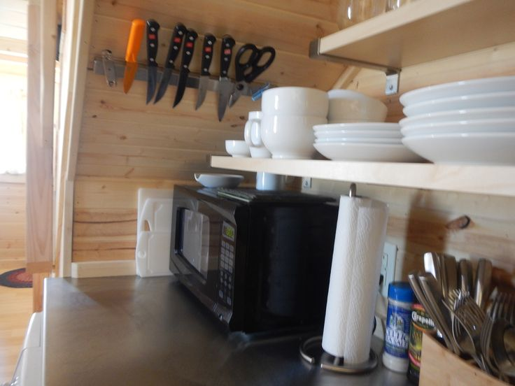 The Sheep House: Knives are stored out of the way, under the stairs. #tinyhousekitchen #tinyhomekitchen #smallkitchen #understairskitchen #thesheephouse