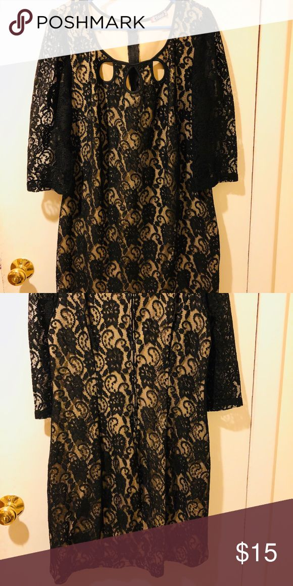 Black and Tan lace dress Black and Tan lace knee length dress. Used- wore couple of times. Dress in great condition. Peekaboo tear drop holes in front. Zippered back. Dresses