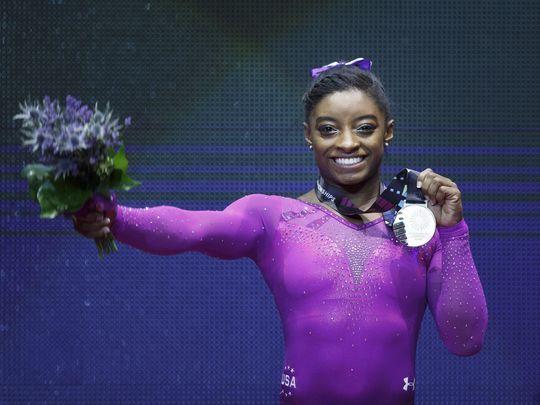 Simone Biles of the USA celebrates winning gold on