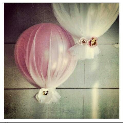Balloons wrapped.in tulle, very pretty.
