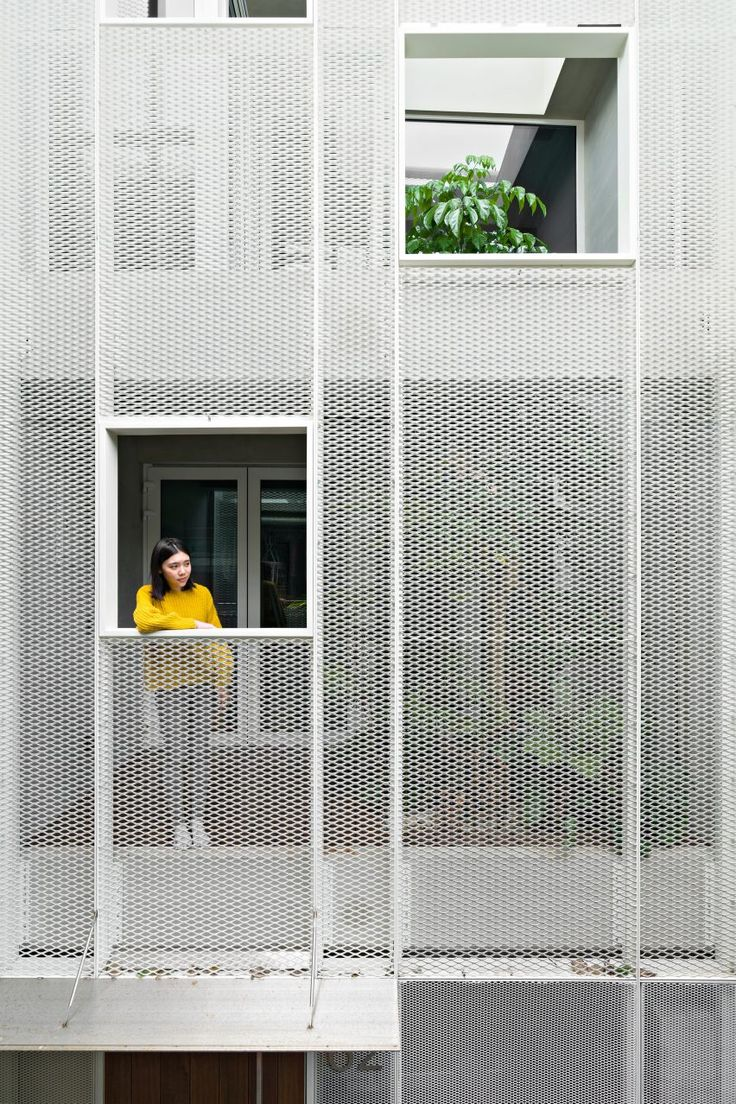 KC Design Studio adds perforated facade and