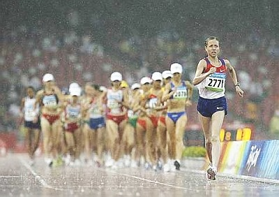 Olga Kaniskina, age 23, of Russia has won the women's 20-kilometer race walk gold medal in a dominating start-to-finish performance in wet conditions at the Beijing Olympics. Finishing in an Olympic record 1 hour, 26 minutes, 31 seconds.