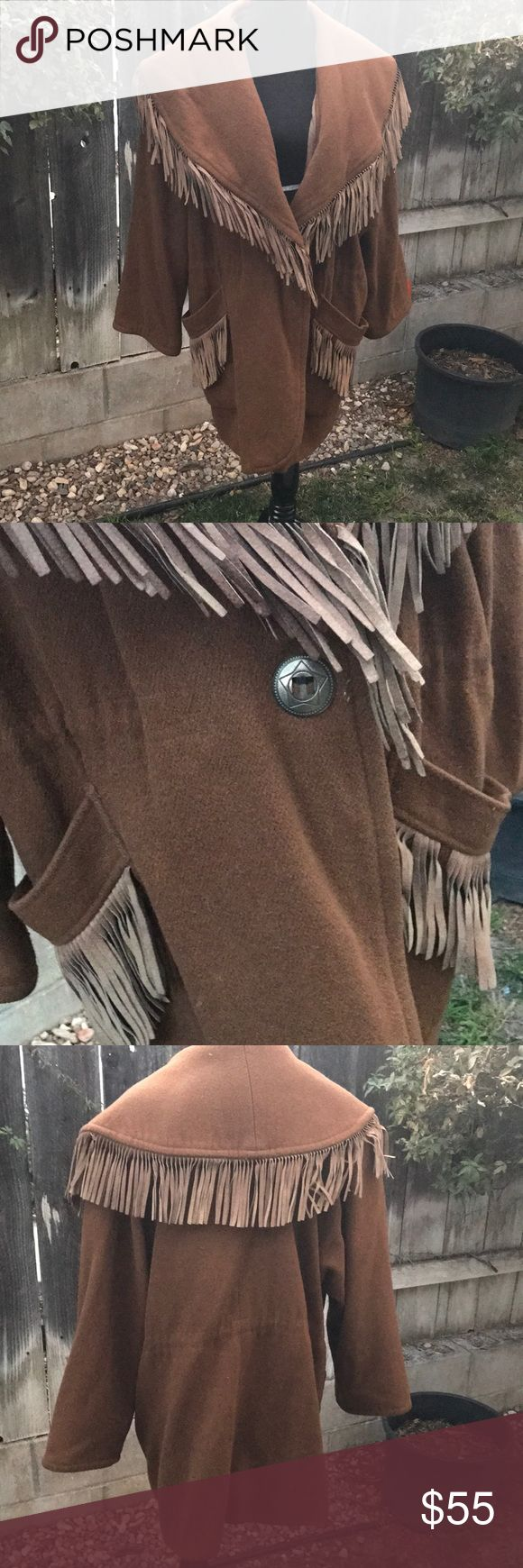 Amazing and WARM Wool and Leather Fringe Coat This coat is HEAVY! It's so amazing and warm...in fact it's way too warm for me on the beach of CA! It's fully lined, vintage, concho button detail. Beautiful, waiting for a chilly home 😊 no size, fits like an XL but will fit a range. Toggle drawstring on both sides to cinch it up if you like.  This item will require extra shipping on my part because it exceeds the five pound weight limit. Vintage Jackets & Coats Capes