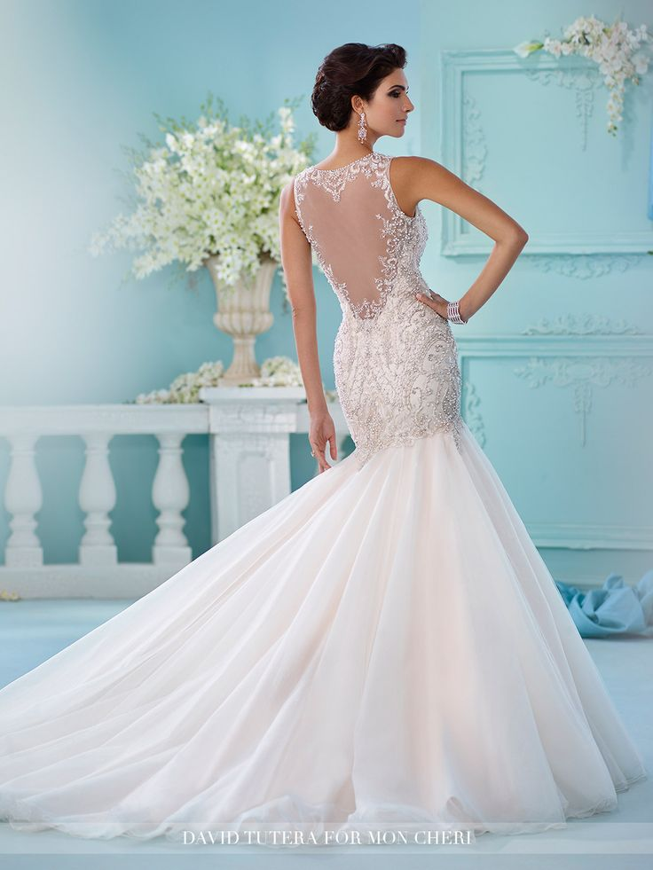 David Tutera for Mon Cheri - 216240 Neela - Sleeveless tulle over satin trumpet gown, illusion jewel neckline with delicate hand-beaded  trim, beaded embroidered motif sweetheart bodice with dropped waistline, beaded illusion low scoop back, softly gathered tulle skirt, chapel length train.  Sizes: 0 - 20, 18W - 26W  Colors: Ivory/Light Gold, Ivory, White