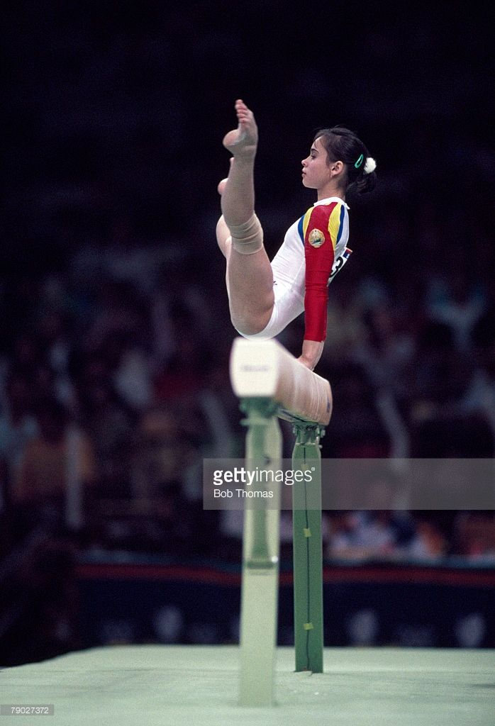 Romanian gymnast Aurelia Dobre competes in the balance beam event, during competition in the gymnastic events, inside the Olympics Gymnastics Hall during the 1988 Summer Olympics in Seoul, South Korea in September 1988. Dobre would go on to finish in 9th place in the event.