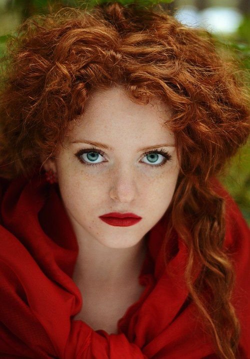Freckles, blue eyes and red lips. 2% of the world are red heads. And there is only 1% of those 2% that have blue or green eyes. Rarity at it's best. And she could totally pull of Merida with little effort lol