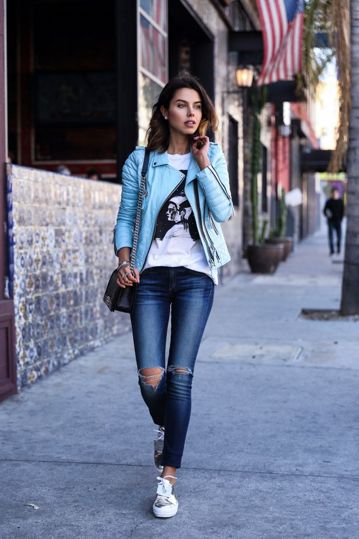 pastel blue jacket with graphic top and skinny jeans