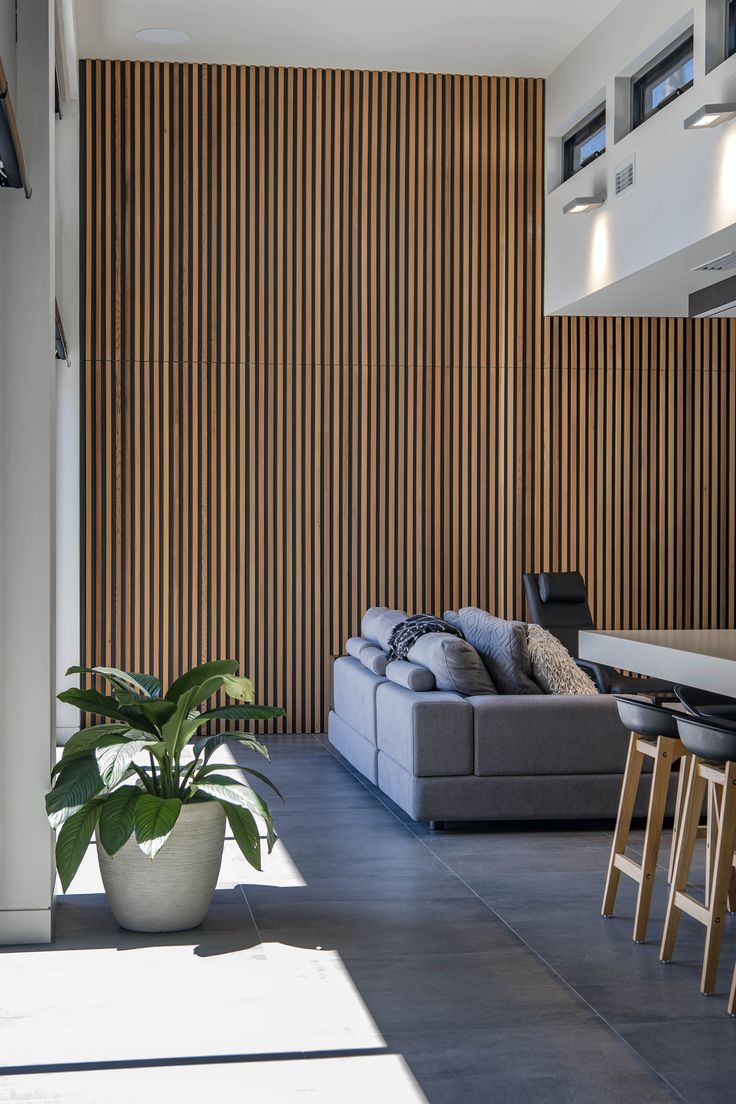 Yarra House II | DNA Architects #interior #architecture #design #house #canberra #residential #modern #timber #battens #feature #detail #secretdoor #featurewall