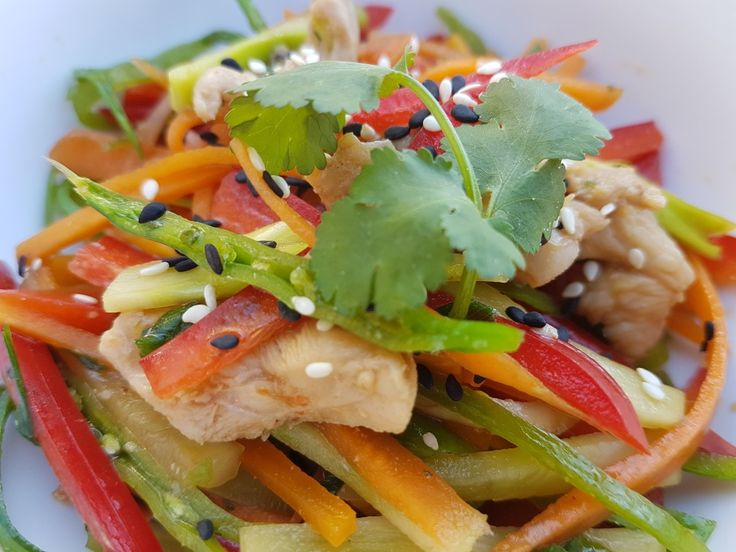 Poached chicken salad with crisp vegetables, herbs, sesame seeds and tangy dressing