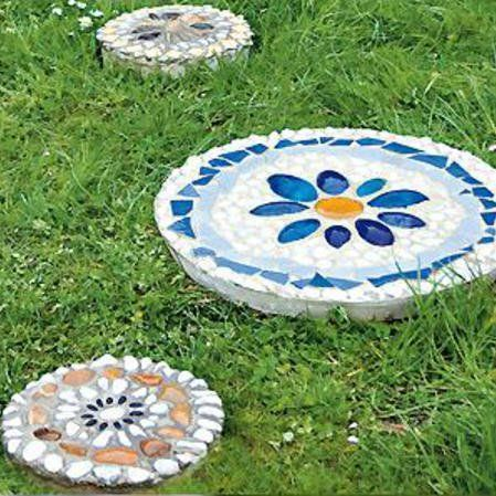 Colorful stepping stones for the garden make with mosaic pebbles and concrete