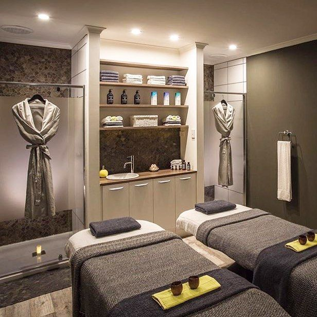 Love the idea of having showers in the room to clean off after a body treatment. Also love the robes hanging up