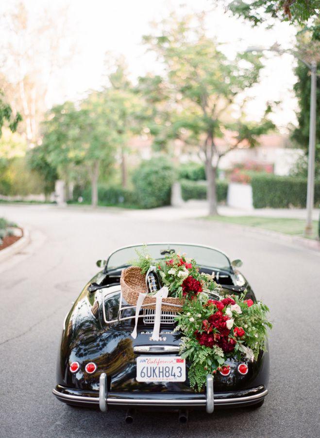 Flower draped get-away Porsche: http://www.stylemepretty.com/vault/gallery/38064 | Photography: Koman Photography - http://komanphotography.com/