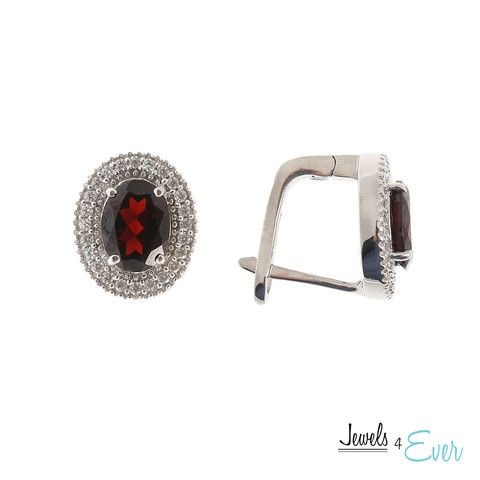 These sparkling earrings exude elegance and sophistication. They go great with office attire or even jeans and a T. Sterling Silver set with 8 x 6 mm genuine Garnet and Cubic zirconia with french clip backing.