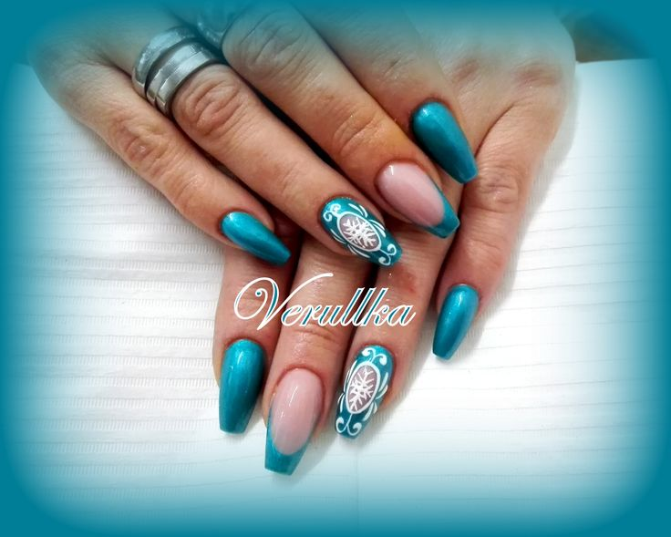 Turquoise gel nails with hand painted decoration