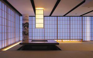 千里中央の家 高層マンションの一室をデザインリフォーム 夜の居間の様子