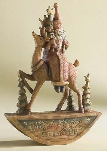 Rocking Santa - Santa sitting on a rocking horse holding gifts. This piece has a very nice wood look in natural tones.