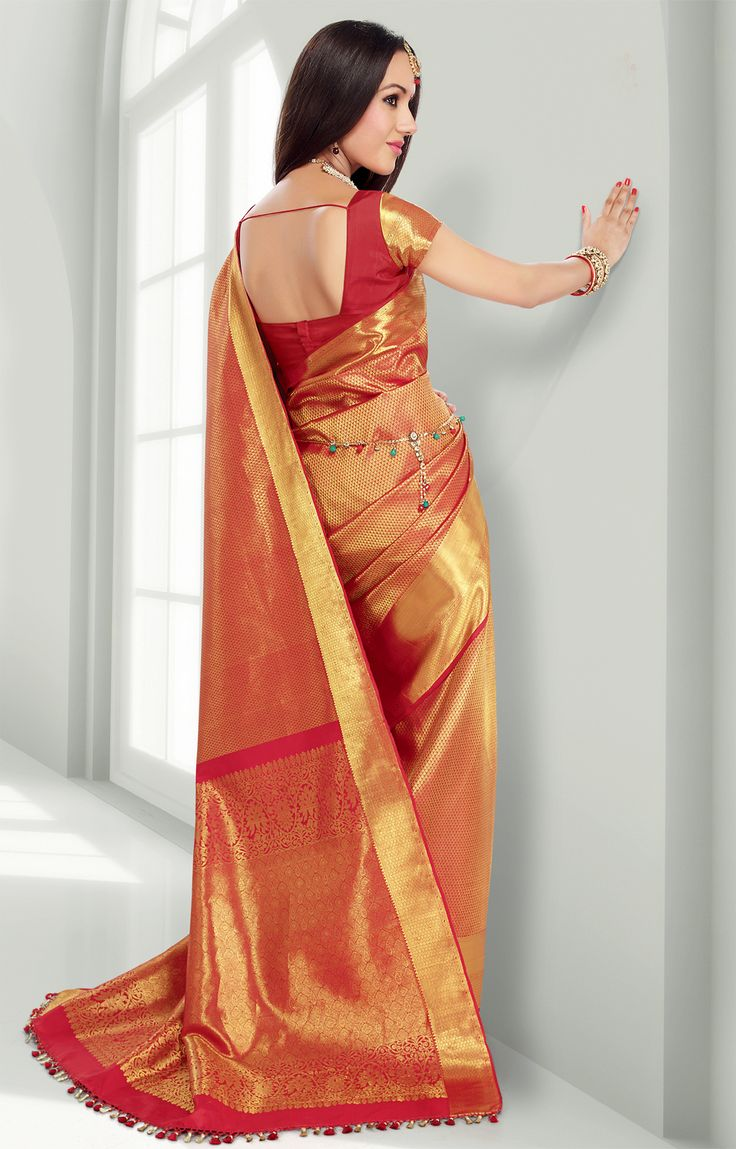 Red pure silk saree with gold motifs throughout the saree and a wide one-side gold border - RmKV Silks
