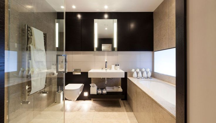 Stylish London Apartment for rent - Henrietta Street (9) This is a bathroom!  Sleek surface materials, a restrained use of color and an excellent use of a smaller space.  And, it's still very sophisticated and masculine.