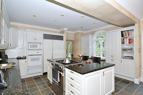 Chef's kitchen featuring double door refridgerator