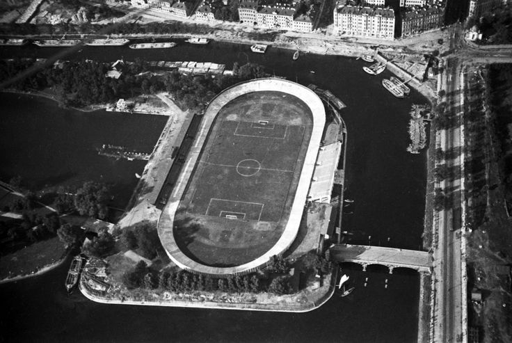 """Petrov Stadium, 1931. On Petrovskii island, washed from both the Malaia Neva and Zhdanovka rivers. From a series of photos of Leningrad from the air, taken for the magazine """"USSR in Construction"""". Russia"""