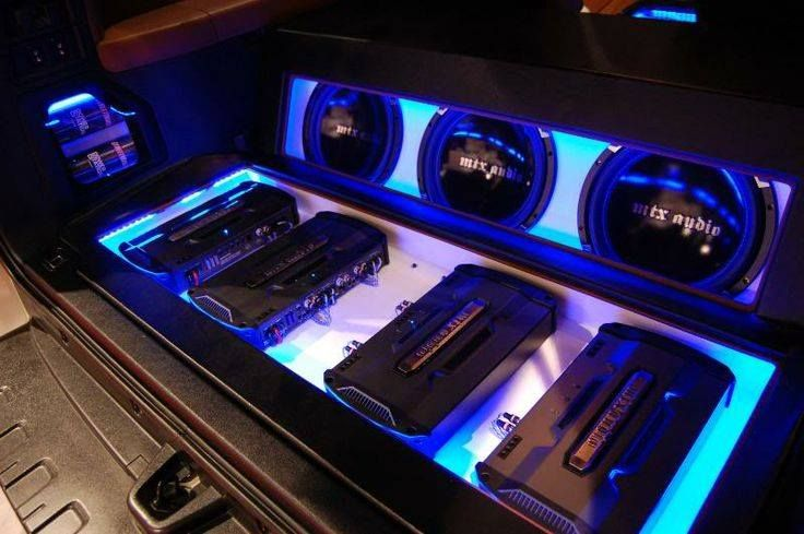 RFL series amplifiers installed in a recessed tray with MTX Audio subwoofers and StreetWires capacitors on display.