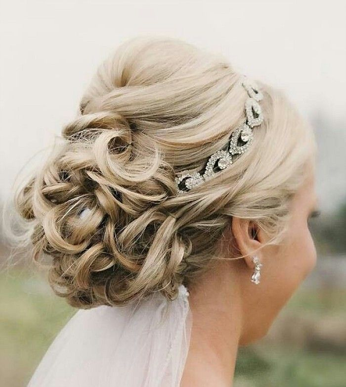 Glorious Beautiful Wedding Updo With Crystal Headband and Veil hairstyle