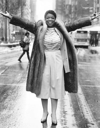 "Oprah Winfrey, then the new host of WLS-TV's morning talk show ""AM Chicago."" strikes a pose on State Street in 1984 for a Chicago Tribune photographer."