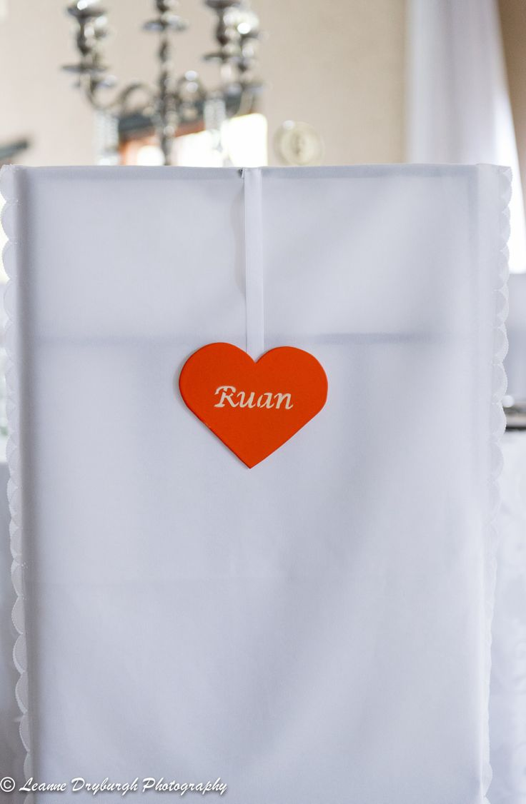 Seating 'cards'-personalized hearts hanging from the chair