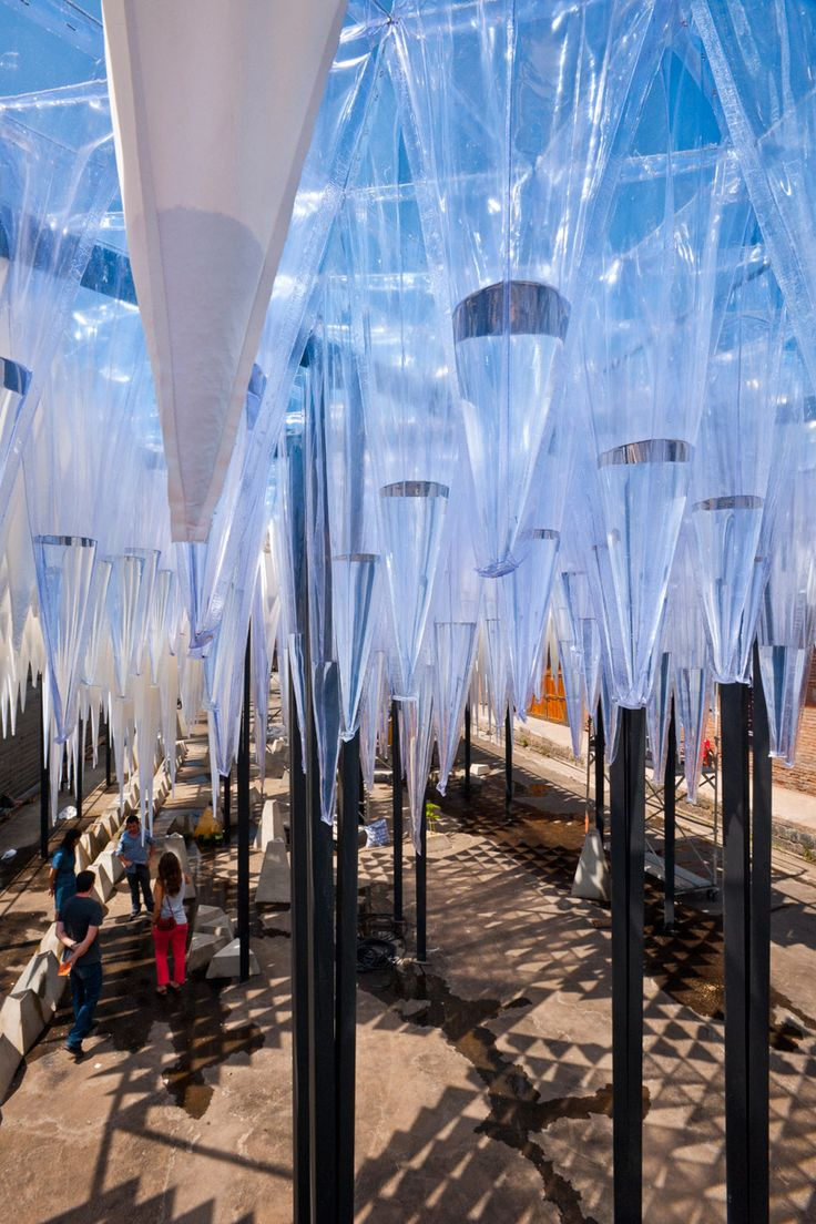'water cathedral' by GUN architects, santiago, chile  image guy wenborne; YAP CONSTRUCTO 2011, courtesy constructo  all images courtesy GUN architectsopen to the sky, plastic cones capture water and slowly release drops over time  image guy wenborne; YAP CONSTRUCTO 2011, courtesy constructo