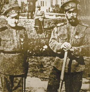 Tsarevich Alexei, Tsar Nicholas II during captivity in Tsarskoe Selo. (Possibly Grand Duchess Olga sit behind them looking on.)